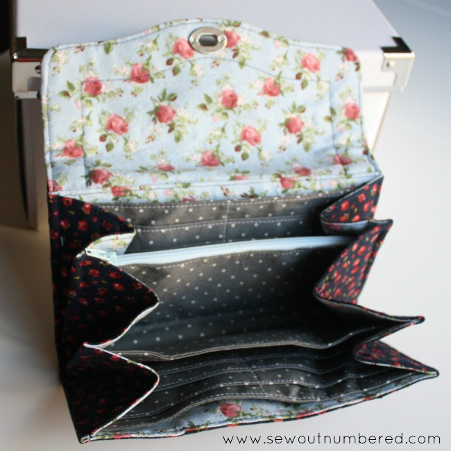 necessary clutch wallet inside